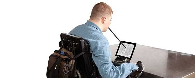 A handicapped person using mouse stick